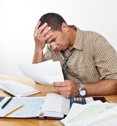 Worried Man with Debt and Bills